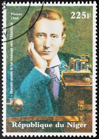 physicist: NIGER - CIRCA 1998. A postage stamp printed by NIGER shows image portrait of famous Italian physicist and inventor Guglielmo Marconi, circa 1998. Editorial