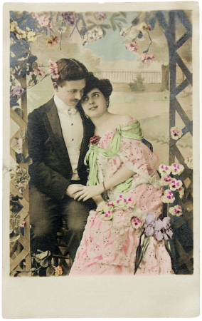 FRANCE - CIRCA 1912. Vintage postcard printed in FRANCE shows hand-tinted photorgaph of man and woman in romantic pose. Circa 1912. Editorial