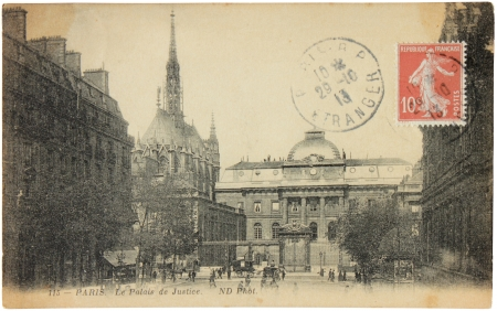 FRANCE - CIRCA 1913: A stamp printed by FRANCE shows Marianne the allegory of French Republic. Stamp is on the old  postcard shows Palace of Justice (Palais de Justice) in Paris, circa 1913.