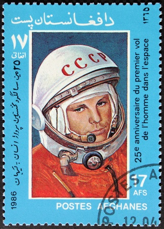 yuri: AFGHANISTAN - CIRCA 1986: A postage stamp printed by AFGHANISTAN shows  image portrait of famous Soviet pilot and cosmonaut Yuri Gagarin, circa1986. Editorial
