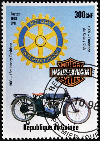 GUINEA - CIRCA 1998. A postage stamp printed by GUINEA shows first motorcycle Harley-Davidson (1903), circa 1998.