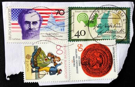 eduard: GERMANY - CIRCA 1981: A set of four stamps printed by Germany shows Marburg University emblem, portraits of German poet Eduard Morike and American statesman Carl Schurz, circa 1981