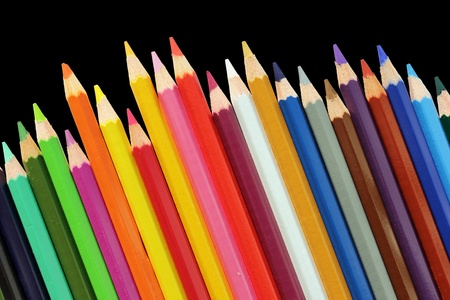 Set of color pencils isolated on a black background photo