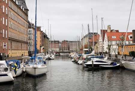 noted: Christianshavn Canal in Copenhagen is noted for its bustling sailing community with numerous sailboats and houseboats.