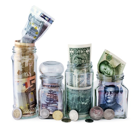 Money jars overflow with Euro, Russian, American and Chinese bank notes and coins against white background. photo
