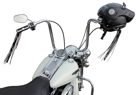 Motorcycle handlebar with helmet. Ape hanger handlebars are popular on chopper motorcycles. photo