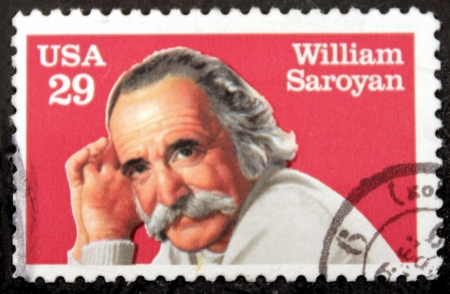 dramatist: UNITED STATES OF AMERICA - CIRCA 1991: a stamp printed in the USA shows William Saroyan, famous Dramatist and Writer, circa 1991