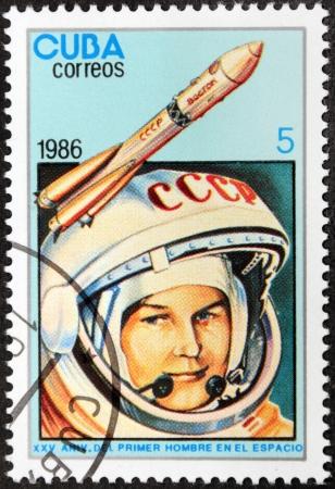 tereshkova: CUBA - CIRCA 1986: A postage stamp printed by CUBA shows  image portrait of famous Soviet woman cosmonaut Valentina Tereshkova and rocket Vostok-6, circa 1986.