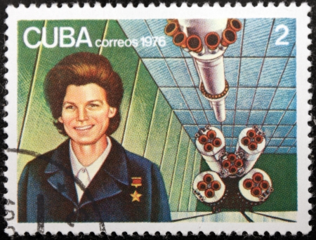tereshkova: CUBA - CIRCA 1976: A postage stamp printed by CUBA shows  image portrait of famous Soviet woman cosmonaut Valentina Tereshkova and rocket Vostok-6, circa 1976.