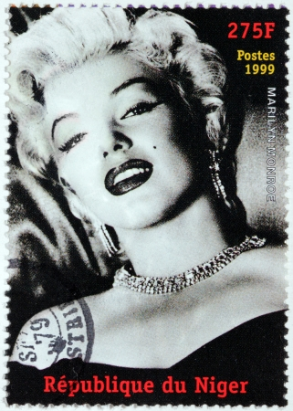 NIGER - CIRCA 1999  A postage stamp printed by NIGER shows image portrait of famous American actress, model and singer Marilyn Monroe  1926-1962 , circa 1999