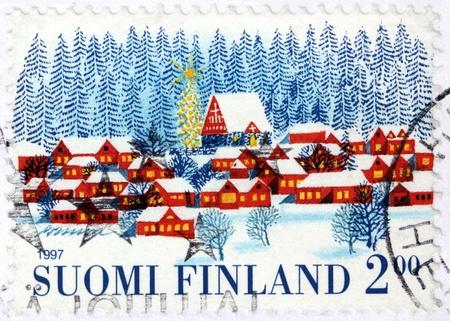 FINLAND - CIRCA 1997: A stamp printed by FINLAND shows idyllic Finnish winter landscape, circa 1997.