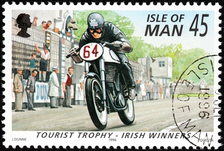 ISLE OF MAN - CIRCA 1996: a stamp printed by GREAT BRITAIN shows winner of International Isle of Man TT (Tourist Trophy) Race - the most prestigious motorcycle race in the world, circa 1996. Stock Photo - 21007828
