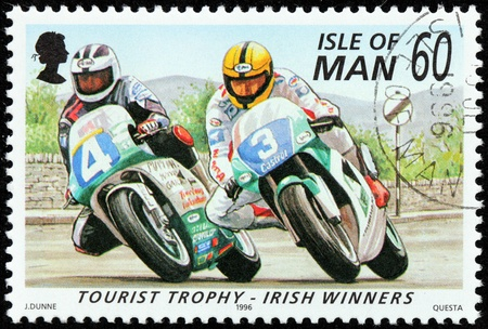 ISLE OF MAN - CIRCA 1996: a stamp printed by GREAT BRITAIN shows winners of International Isle of Man TT (Tourist Trophy) Race - the most prestigious motorcycle race in the world, circa 1996. Stock Photo - 21323827