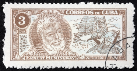ernest: CUBA - CIRCA 1963: A stamp printed by CUBA shows image portrait of Nobel Prize-winner for Literature famous American writer Ernest Hemingway (1899-1961), The Old Man and The Sea, circa 1963 Editorial