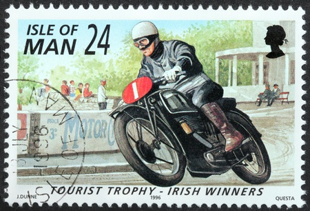 ISLE OF MAN - CIRCA 1996: a stamp printed by GREAT BRITAIN shows winner of International Isle of Man TT (Tourist Trophy) Race - the most prestigious motorcycle race in the world, circa 1996. Stock Photo - 21323862
