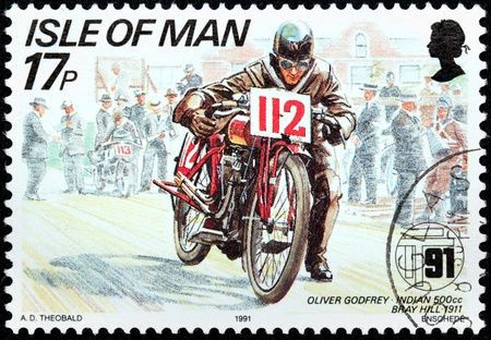 ISLE OF MAN - CIRCA 1991: a stamp printed by GREAT BRITAIN shows winner of International Isle of Man TT (Tourist Trophy) Race - the most prestigious motorcycle race in the world, circa 1991. Stock Photo - 21323517