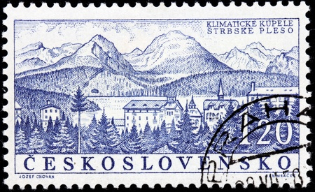 CZECHOSLOVAKIA - CIRCA 1958: A stamp printed by Czechoslovakia shows beautiful view of Strbske Pleso - a favorite ski, tourist, and health resort in the High Tatras, Slovakia, circa 1958.