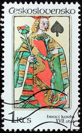 CZECHOSLOVAKIA - CIRCA 1984: a stamp printed by Czechoslovakia shows image of ancient playing card - Queen of Spades, circa 1984. Stock Photo - 21323519