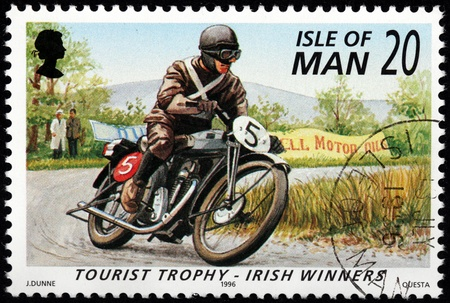 ISLE OF MAN - CIRCA 1996: a stamp printed by GREAT BRITAIN shows winner of International Isle of Man TT (Tourist Trophy) Race - the most prestigious motorcycle race in the world, circa 1996. Stock Photo - 21332928