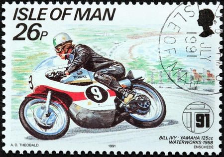 ISLE OF MAN - CIRCA 1991  a stamp printed by GREAT BRITAIN shows winner of International Isle of Man TT  Tourist Trophy  Race - the most prestigious motorcycle race in the world, circa 1991  Stock Photo - 21333389