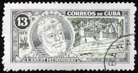 ernest: CUBA - CIRCA 1963  A stamp printed by CUBA shows image portrait of Nobel Prize-winner for Literature famous American writer Ernest Hemingway  1899-1961 , circa 1963