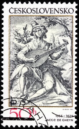 CZECHOSLOVAKIA - CIRCA 1982: A stamp printed by Czechoslovakia shows the lute player - engraving by Dutch painter and engraver Jacob de Gheyn (1565-1629), circa 1982. Stock Photo - 21368435