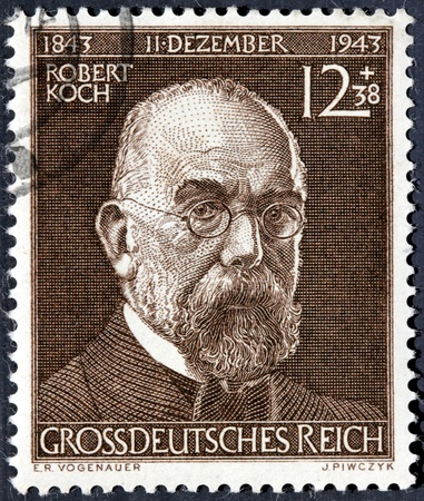 robert: GERMANY - CIRCA 1943: a stamp printed by GERMANY shows image portrait of Robert Heinrich Herman Koch - the founder of modern bacteriology, discoverer of Tubercle Bacillus, circa 1943.