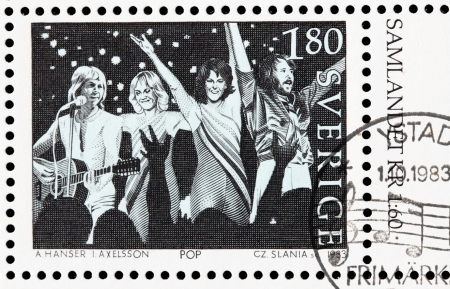 SWEDEN - CIRCA 1983: a stamp printed by Sweden shows image of famous Swedish musicians from ABBA band, circa 1983.