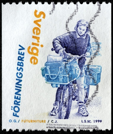 SWEDEN - CIRCA 1999: a stamp printed by SWEDEN shows Swedish woman letter-carrier with bicycle, circa 1999.  Stock Photo - 22034284
