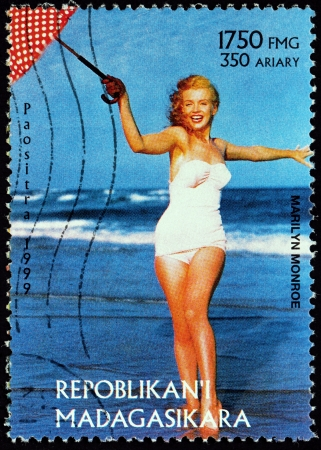MADAGASCAR - CIRCA 1999: A postage stamp printed by MADAGASCAR shows image portrait of famous American actress, model and singer Marilyn Monroe (1926-1962), circa 1999