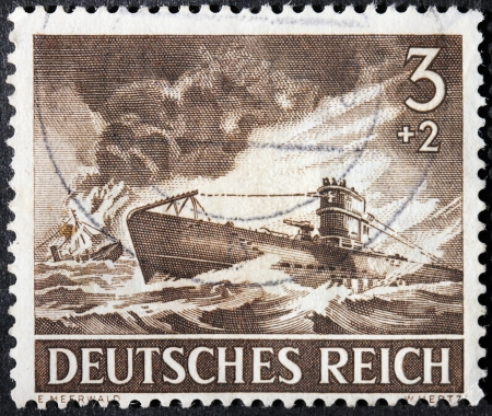 GERMANY - circa 1943: stamp printed by Germany, shows German submarine in action against convoy, circa 1943. Stock Photo - 22716044