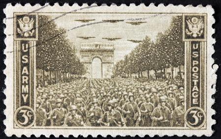 UNITED STATES - CIRCA 1945: stamp printed by United States shows U.S. Troops Passing Arch of Triumph at Paris, circa 1945