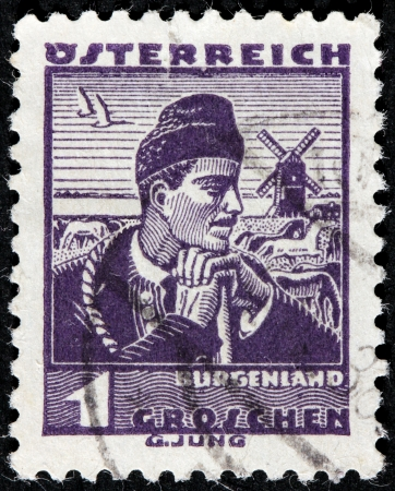herder: AUSTRIA - CIRCA 1934: A stamp printed by AUSTRIA shows Man from Burgenland, Traditional folk costume, circa 1934.