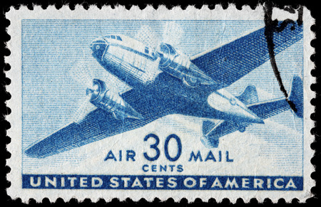 UNITED STATES OF AMERICA - CIRCA 1941: A stamp printed by USA shows two engine transport plane, circa 1941