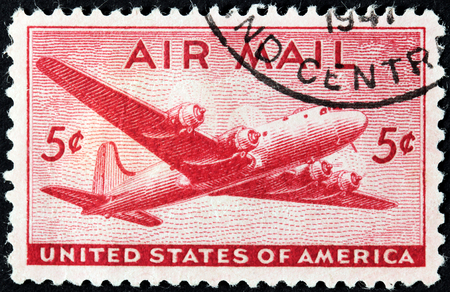 UNITED STATES OF AMERICA - CIRCA 1941: A stamp printed by USA shows four-engined transport aircraft, circa 1941