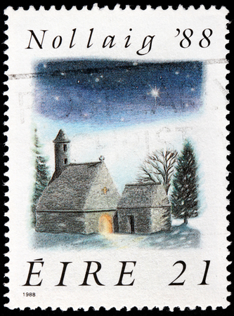IRELAND - CIRCA 1988: a stamp printed by IRELAND shows view of St. Kevins Church, Glendalough, circa 1988.