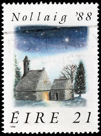 irish christmas: IRELAND - CIRCA 1988: a stamp printed by IRELAND shows view of St. Kevins Church, Glendalough, circa 1988.