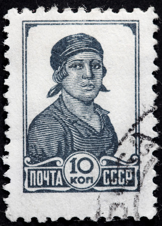 workwoman: USSR - CIRCA 1936: a stamp printed by Soviet Union (Russia) shows portrait of Female Worker against white background, circa 1936. Editorial