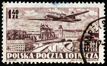 POLAND - CIRCA 1952: A stamp printed by POLAND shows airplane and birds-eye view of  Warsaw, circa 1952