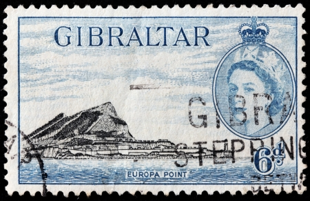 GIBRALTAR - CIRCA 1953: A stamp printed by GIBRALTAR shows image portrait of Queen Elizabeth II and view of Gibraltar, circa 1953.