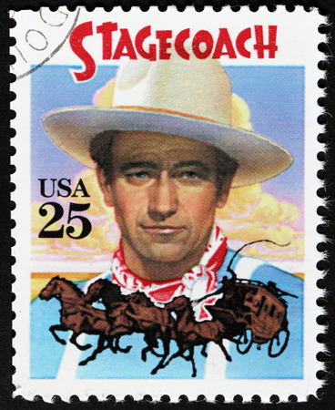 john wayne: UNITED STATES - CIRCA 1990: Astamp printed by USA shows an image portrait of American actor John Wayne as The Ringo Kid in Stagecoach Western film, circa 1990.