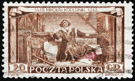 copernicus: POLAND - CIRCA 1953: A stamp printed by POLAND shows portrait of Nicolaus Copernicus. Copernicus was a Renaissance mathematician and astronomer who formulated a heliocentric model, circa 1953 Editorial