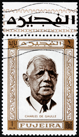 charles de gaulle: FUJEIRA - CIRCA 1969: A postage stamp printed by FUJEIRA shows image portrait of famous French general and statesman, President of the French Republic Charles de Gaulle, circa 1969. Editorial