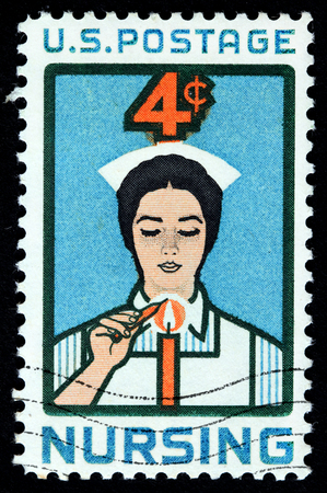 UNITED STATES OF AMERICA - CIRCA 1961: A stamp printed by USA shows image of Nurse Lighting Candle, circa 1961.