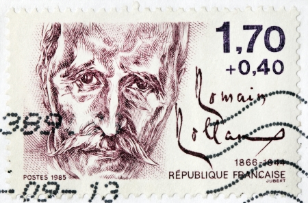 dramatist: FRANCE - CIRCA 1985: A stamp printed by FRANCE shows image portrait of French dramatist, novelist, essayist, art historian and mystic Romain Rolland who was awarded the Nobel Prize for Literature, circa 1985 Editorial