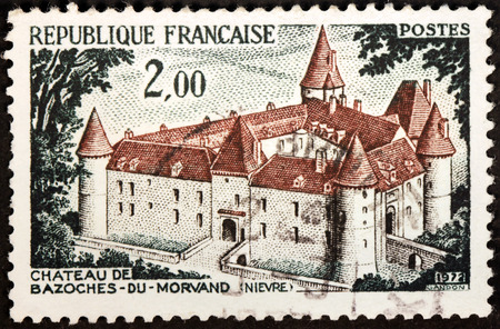 FRANCE - CIRCA 1972: A stamp printed by FRANCE shows view of Chateau de Bazoches-Du-Morvand at the Nievre department, Burgundy, France, circa 1972