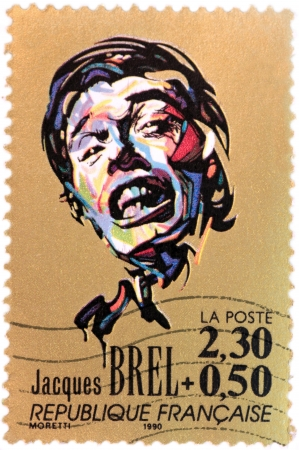 jacques: FRANCE - CIRCA 1990: A stamp printed by FRANCE shows image portrait of a famous Belgian singer-songwriter Jacques Brel, circa 1990.