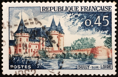 sully: FRANCE - CIRCA 1961: A stamp printed by FRANCE shows image of Sully-sur-Loire castle, the historic seat of the ducs de Sully, circa 1961