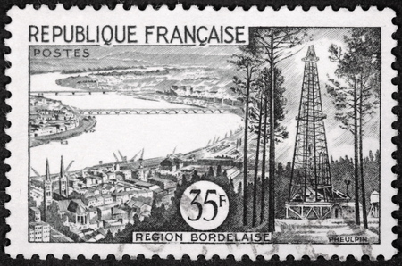 gironde department: FRANCE - CIRCA 1955: A stamp printed by FRANCE shows view of Bordeaux, Gironde Department, France - The Garonne river, the bridges, and the spires of the Cathedral, circa 1955.