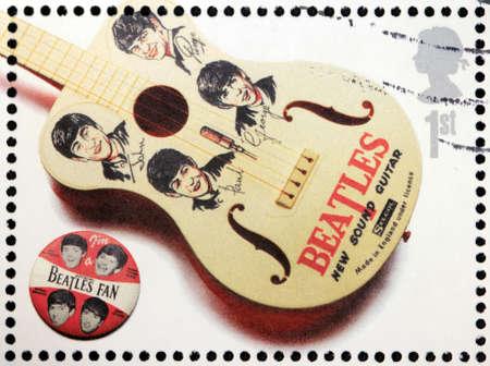 memorabilia: GREAT BRITAIN - CIRCA 2007: A stamp printed by Great Britain shows the Beatles memorabilia (guitar and pin), circa 2007.